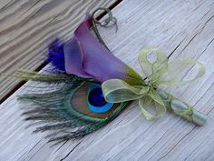 Purple calla lily peacock corsages (bout)