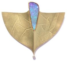 Eve Llyndorah Design A sting ray with a mouthful of sea water. Cool piece...great to ornament ears. K.W.