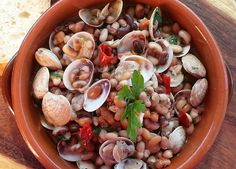This week Amy Gulick shares a recipe that takes inspiration from the classic 'vongole'(clam) dish from the Campagnia region. A hearty clam soup with beans that will make anyone's mouth water.
