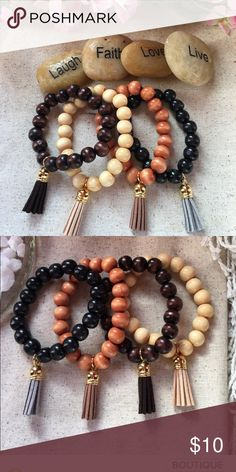 Four natural wooden beads with tassels These beaded bracelets are 10mm and size 6 1/2 on stretchable cord, all four come with a tassel all you can wear them all together or separate. Price is firm Jewelry Bracelets