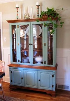 This china cabinet was purchased for $65 at a garage sale and painted to give it a new look.