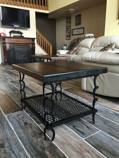 This table is: - 21 tall -23.5x29.5 - has a 2 thick hemlock top ( other wood options available) - base is steel horseshoes with an expanded steel shelf - the base is powder coated satin black