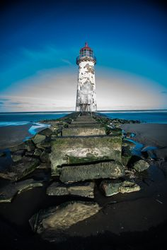 Point of Ayr Lighthouse - as sun was very strong and high with no clouds in the sky, have used 10 stop filter. but central part of image was overexposed. after post processing in lightroom only, thats final image i have got