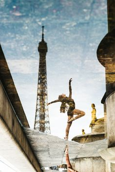 Ballerina dancing in front of the Eiffel Tower. Reflection in a rain puddle in Place de Trocadéro. Ballet picture taken by Paris photographer Fran Boloni, The Paris Photographer