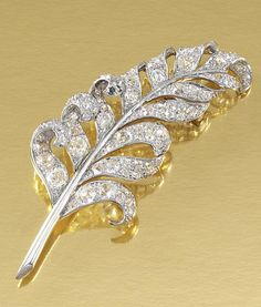 DIAMOND BROOCH, FONTANA, 1950S. Designed as a stylised feather, set throughout with circular-, rose-cut and cushion-shaped diamonds, signed Fontana Paris, French assay marks.