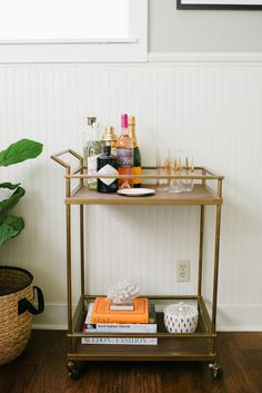 brass bar with books and accessories // bars