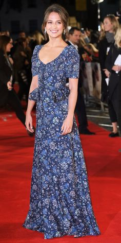 Alicia Vikander and beau Michael Fassbender made a date night out of The Light Between Oceans premiere—she graced the red carpet in a romantic floral-print custom Louis Vuitton featuring tiny puffed-up shoulders and a ruffled peplum. The finishing touch? Diamond earring