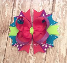 Bright multi color stacked shimmery boutique hair bow by susansamazingbows on Etsy