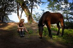 Amber Marshall in Hawaii with a mare she found! The horses just come to her! Lol!!