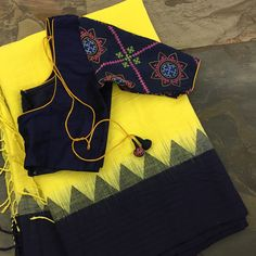 This yellow/navy blue linen temple border saree has been woven using a technique of three shuttle weaving and a interlocking weft. Saree Blouse Neck Designs, Half Saree Designs, Fancy Blouse Designs, Kutch Work Designs, Stylish Blouse Design, Designer Blouse Patterns, Stylish Sarees, Fancy Sarees, Navy Blue