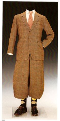 Prince of Wales check sports suit.  Jacket by Scholte of London and stalking trousers (modified plus-fours) by Forster & Sons, 1923.  Altered in the mid 1930s when a zip was inserted.  Came with the removable blue cotton plus-four linings (more below)