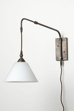 I would mount this scone at my desk... I much prefer a wall-mounted desk light to a table lamp.