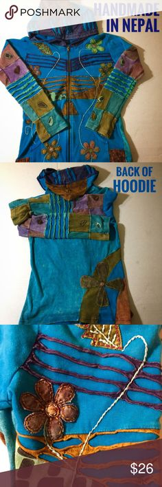 "Awesome Handmade Hoodie 100% Cotton Handmade Hoodie, by Rising International. Has hand warmer pouch, and zip open front, zipper is heavy type. A rainbow of colors. Sleeve-23"", Length-24"", Chest-19.5"". This is a BOHO style item, so it has a intentional worn, natural appearance, but it is in Excellent used condition, no stains or holes. Fabulous for layering, as a light jacket, or alone as a Winter Top. Bundle to save 15%, check out the BOGO area at the back of the closet. Please come back…"