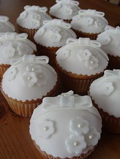 Indian Weddings Inspirations. White cupcakes. Repinned by #indianweddingsmag #weddingcupcakes #bakery indianweddingsmag.com