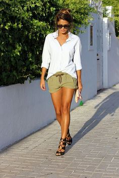 Soft button-down tucked into casual shorts.