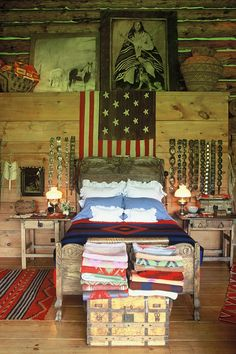 In the main bedroom, the flag above the bed is in fact an antique blanket; the bed linen is by Ralph Lauren.