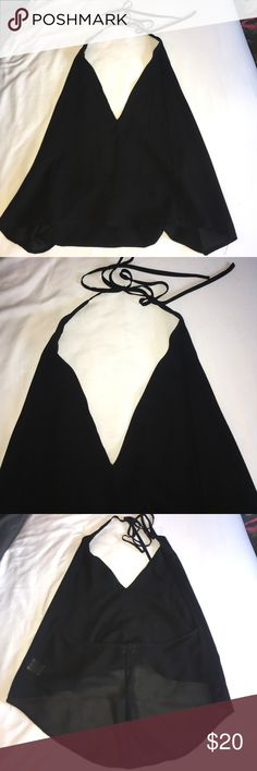 SEXY Going out Halter Black Open Back Halter fancy shirt. This shirt has never been worn. Smaller bra sizes will fit more comfortably. Totally open back. Deep v neck. Adjustable straps. Super trendy & cute!!! Tops Blouses