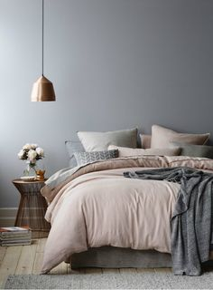 Bedroom in a colour scheme of grey and rose quartz