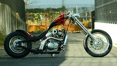 Honda Shadow vt600 hardtail custom with downtube/backbone stretch and flame paint job by Goods Co. Customs | right side
