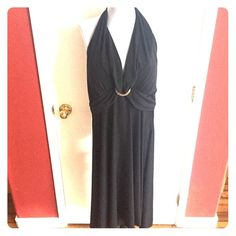 Gorgeous black halter dress This is a NWT dress. It is a reposh because it's to big for me! Love this dress but does not fit! It is lightly padded and comes just below the knees.  My Michelle Dresses Midi