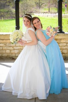 Blue bridesmaid dress--a little bit brighter.  The bouquet really compliments it as well. Julia and her bridesmaid in blue bridesmaid dresss