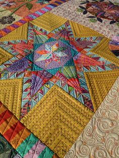 Quilted by Judi Madsen.  I love this fun and colorful block!