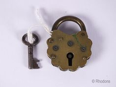 Victorian Brass Padlock With Key  Antique Petal Shaped Brass Padlock. Complete with a Key. Believed to date to the Victorian era - circa lat...