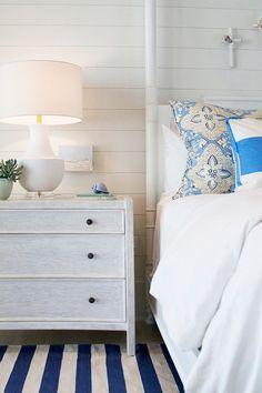 Master Bedroom. Master bedroom furniture and decor. Master bedroom with blue and white decor, blue and white fabric, blue and white stripe rug, whitewash furniture, shiplap walls and coastal decor. #bedroom #MasterBedroom Meredith McBrearty.