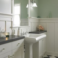 Green And White Powder Room With Board And Batten Wainscoting   Kohler  Memoirs Wide Pedestal Sink Is Flanked By Deep Bathroom Vanity Cabinets  Topped With ...