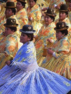 "via www.mountainadventures.com         La Paz, Bolivia. Aymara women dancing in the parade for the ""Gran Poder"", the largest festival of the year for the entire country."