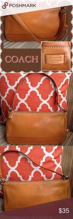 COACH Tan Leather Demi Shoulder Bag This bag has been loved, but has some more life in it. The interior is in good shape. There is some wear on the outer corners. One corner is worn through.  The shoulder strap measures 16 inches. Coach Bags Mini Bags