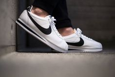On foot shots of the Nike Classic Cortez Premium QS Black & White. Available now.  http://ift.tt/1YaNsCX Nike Cortez Black, Nike Classic Cortez, Black Sneakers, Sneakers Nike, Sneakers Fashion, Cortez Shoes, Snicker Shoes, White Nikes, Nike Shoes Outlet