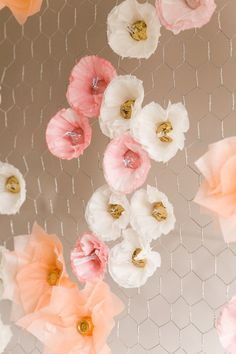 DIY Hershey Kiss Floral Backdrop - http://ruffledblog.com/diy-hershey-kiss-floral-backdrop