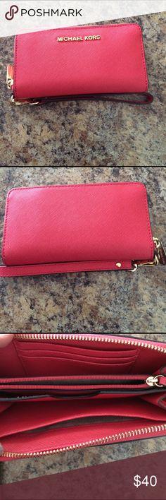 Michael Kors wallet Beautiful Michael Kors wallet. Great condition! Salmon color Michael Kors Bags Wallets