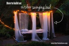 Twinkle lights and sheer drapes glam up an outdoor swinging oasis.