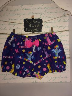 My Little Pony Diaper Cover/Bloomer for baby girl. Size 12-18M. All the colorful cartoon characters on this dark purple bluish pair. by SoSewSweetCreations on Etsy