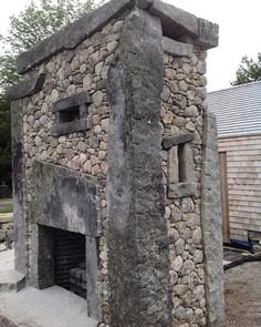 Side view or outdoor fireplace. Fireplace Facing, Fireplace Surrounds, Fireplace Design, Rustic Outdoor Fireplaces, River Rock Fireplaces, Stone Masonry, Traditional Fireplace, Rustic Stone, Natural Homes