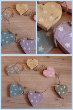 Distressed wooden heart garland with painted daisy's.   £9.50  www.chicyrachael.com