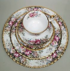 "Royal Albert ""Autumn Roses"" pattern fine bone china England 5 place setting cup, saucer, dessert plate , salad plate and dinner plate"