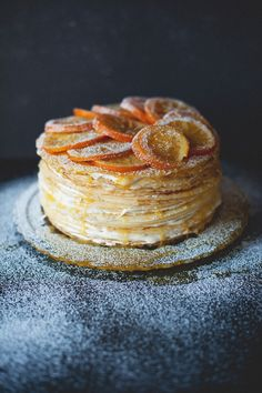 Crêpes Suzette cake (recipe). I really want to make a crepe cake. I love citrus flavored treats...this may be the recipe that pushes me to do it.