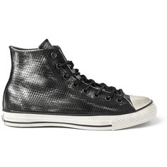 Inject your everyday look with rebellious attitude in these silver and black snake-print sneakers by John Varvatos for Converse. The classic high top design has been reinvigorated by the famous...
