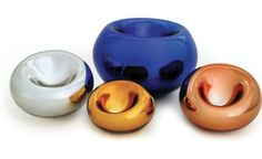 Assymetrical vessels made of hand blown Czech glass with a beautiful metallic reflecting surface. Their eye catching colors and mirrored finish give them a distinctive and unique look.
