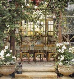by Sandy Koepke  Recycled windows and doors frame an outdoor room.... Recycled french door screen... door panels... tall glass windowed door...