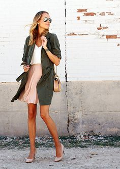 Fashion Jackson puts a flirty twist on the military trend by pairing this olive trench dress with a blush pleated skirt