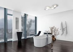 Modern contemporary luxury bathroom interior with freestanding bathtub, black lounge chair and fireplace. Gray Bathroom Decor, Bathroom Interior, Luminaire Led, Luminaire Design, Grey Baths, Apartment Walls, Black Lounge, Small Apartment Decorating, Germany