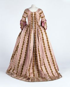 Robe and petticoat, Scotland, Great Britain (possibly, made), France (woven), 1774-1775 (made), 1880-1890 (altered), This is a very rare example of a velvet used in 18th century women's dress. This particular combination of the chiné technique with a silk pile is unusual. It was a difficult technique and only produced in a few places in France.