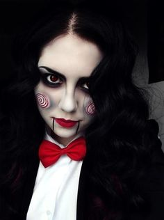 With the classic Jigsaw Halloween makeup, you'll be sure to have the creepiest costume of all. Using super smudged black eyeshadow, create dark eyes, then use white eyeliner and red lipstick to create the swirls on the cheeks. Finish with red lipstick, blacklines comingfrom the corners of your mouth down to your chin and your set!