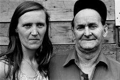 Steven Rubin - Up Close: A man and woman pose for a portrait together against a wooden wall