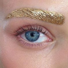 COLOURED BROWS -- Brows are always the colour of your hair but in this look, they're gold and amazing.