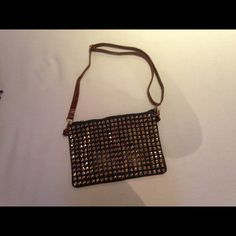 Studded Denim clutch/cross body or Reg bag Gold studded Denim bag with brown strap. You can use with strap or make it a clutch. new Bags Shoulder Bags
